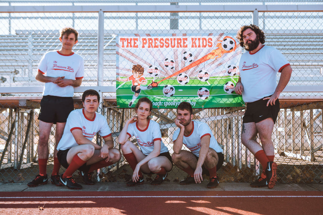 """The Pressure Kids take to the pitch in """"Team"""" music video"""