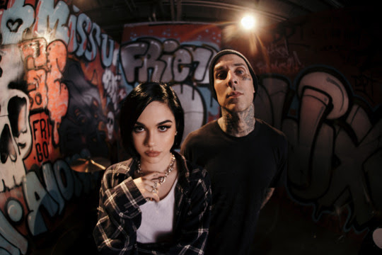 "Maggie Lindemann shares ""Friends Go"" music video with Travis Barker"