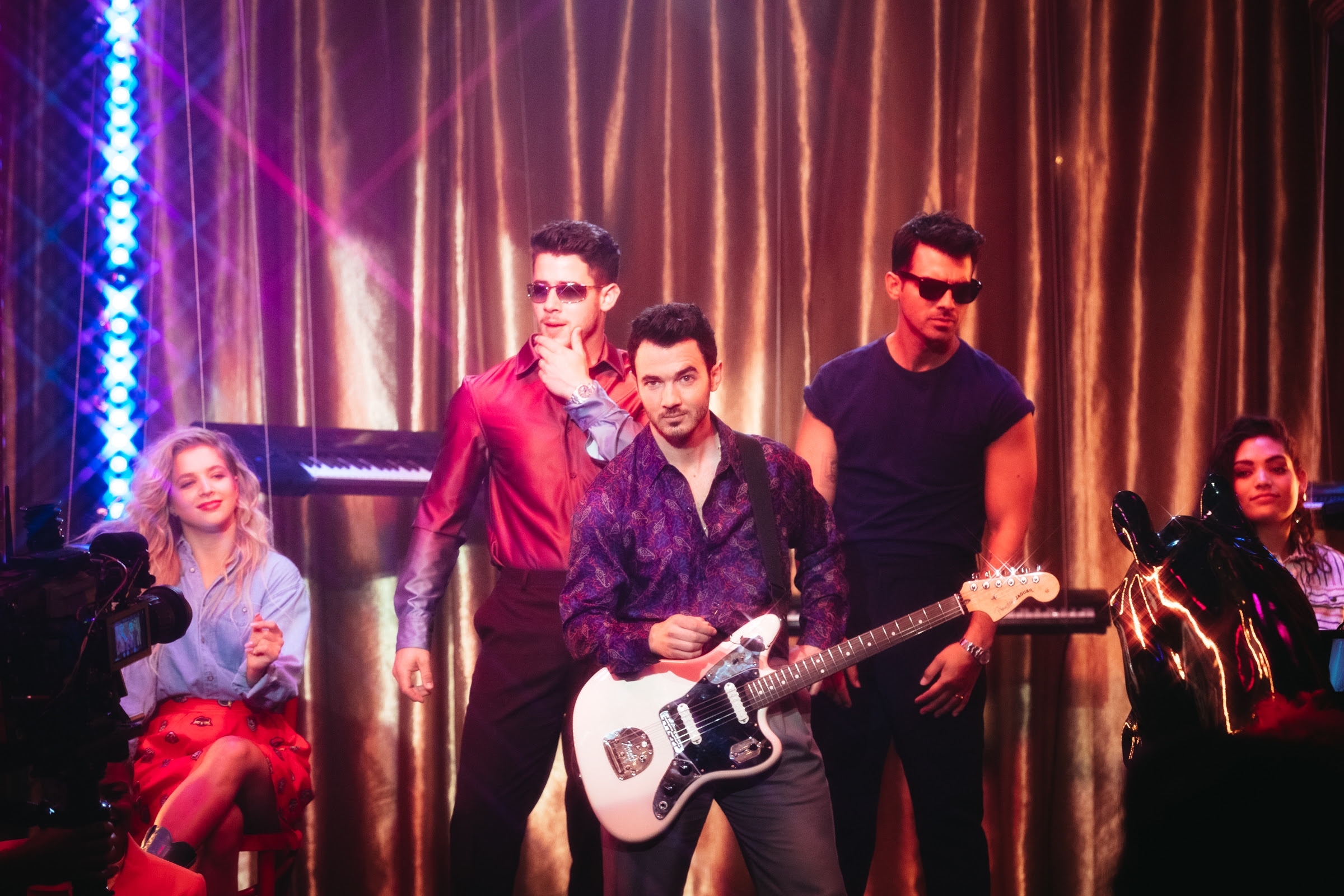 """Jonas Brothers pay tribute to the '80s in video for """"Only Human"""""""